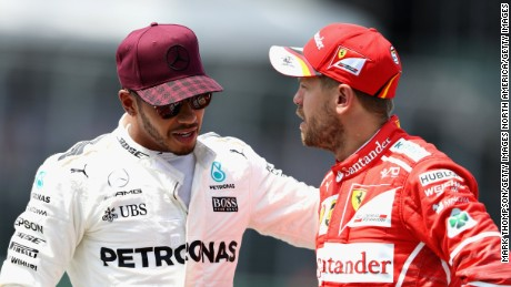 MONTREAL, QC - JUNE 10: Pole sitter Lewis Hamilton of Great Britain and Mercedes GP talks with second placed qualifier Sebastian Vettel of Germany and Ferrari in parc ferme during qualifying for the Canadian Formula One Grand Prix at Circuit Gilles Villeneuve on June 10, 2017 in Montreal, Canada.  (Photo by Mark Thompson/Getty Images)