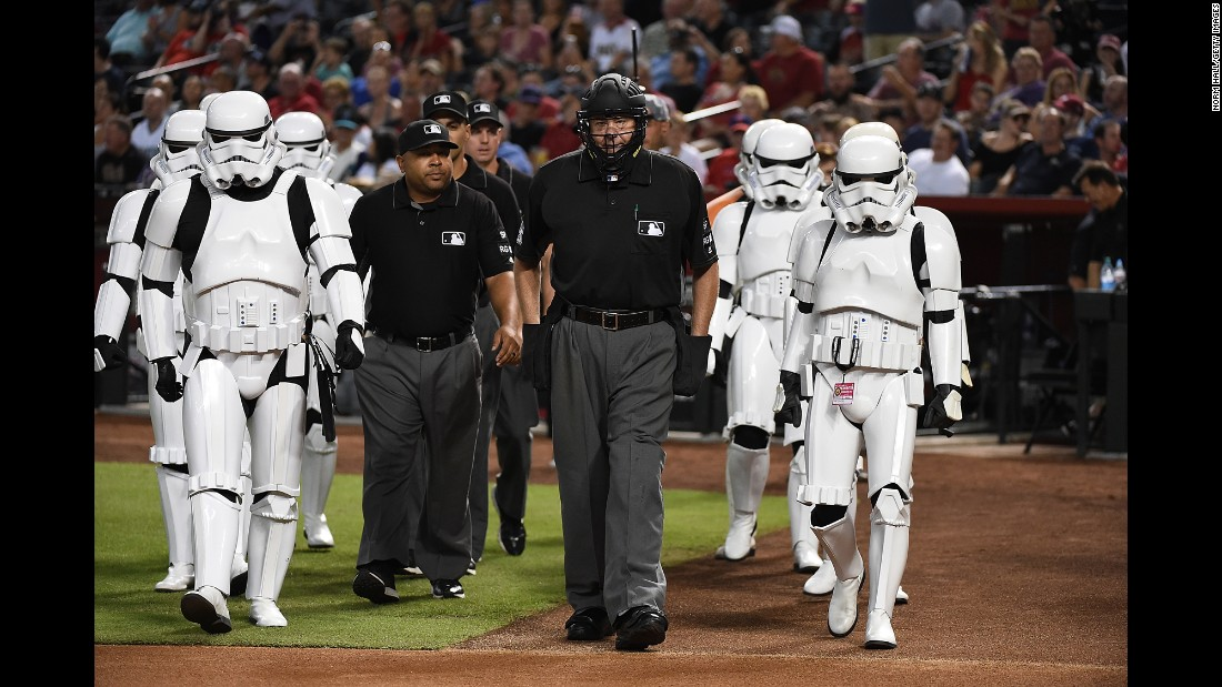 """Star Wars"" stormtroopers escort umpires to home plate before a Major League Baseball game in Phoenix on Saturday, June 24. It was ""Star Wars Night"" at Chase Field."