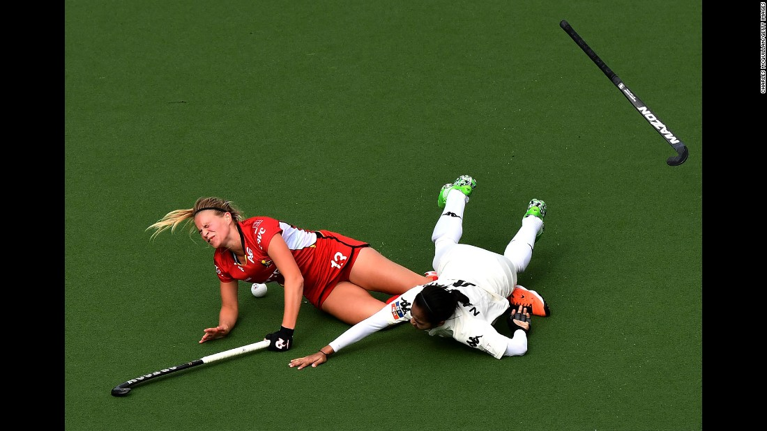 Belgium's Alix Gerniers, left, is fouled by Malaysia's Nurul Mansur during a Hockey World League game on Saturday, June 24.