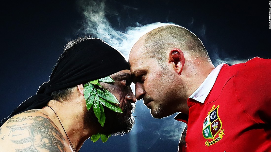A Maori warrior greets rugby player Rory Best during a pre-match ceremony in Hamilton, New Zealand, on Tuesday, June 20. Best plays for the British & Irish Lions, who are touring New Zealand this month.