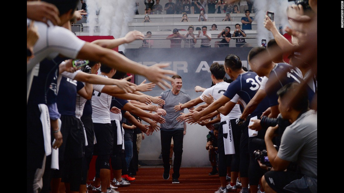 NFL quarterback Tom Brady is greeted by fans during a promotional event in Shanghai, China, on Tuesday, June 20.