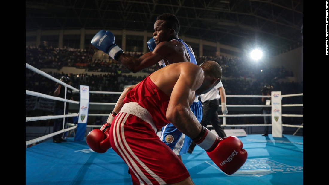 Congo's Mulumba Mbaya, in blue, boxes Egypt's Eslam Ahmed Aly Mohamed during the African Championships on Saturday, June 24.