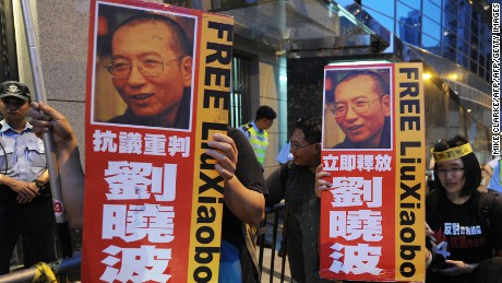 Protestors demonstrate to free Liu Xiaobo outside the Chinese Foreign Ministry in Hong Kong on October 8, 2010.