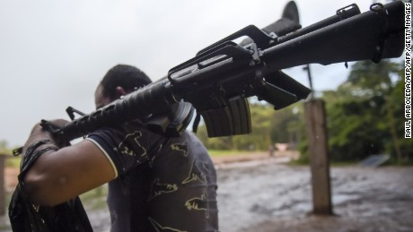 A member of the Revolutionary Armed Forces of Colombia (FARC) gets ready for his guard shift at the Transitional Standardization Zone Jaime Pardo Leal in Colinas, Guaviare  department, Colombia on June 14, 2017.  Colombia's FARC rebels handed some weapons earlier this month, in what were described as meaningful strides toward a deadline for a total surrender of arms next June 20th. / AFP PHOTO / RAUL ARBOLEDA        (Photo credit should read RAUL ARBOLEDA/AFP/Getty Images)