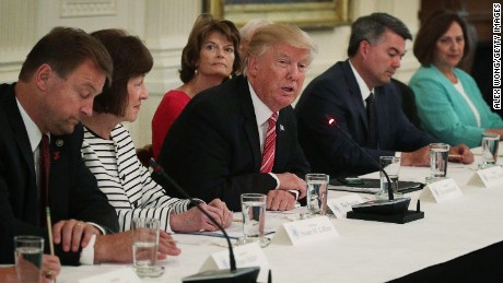WASHINGTON, DC - JUNE 27:  U.S. President Donald Trump (4th L) speaks as (L-R) Sen. Dean Heller (R-NV), Sen. Susan Collins (R-ME), Sen. Lisa Murkowski (R-AK), Sen. Cory Gardner (R-CO) and Sen. Deb Fischer (R-NE) listen during a meeting with Senate Republicans at the East Room of the White House June 27, 2017 in Washington, DC. President Trump invited all GOP Senate members to the White House to discuss the Health Care bill.  (Photo by Alex Wong/Getty Images)