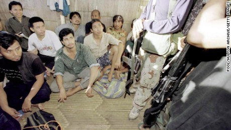Malaysian hostages are guarded by two ASG militants in 2000.