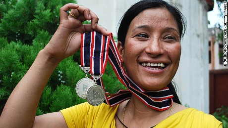 Jamsenpa receives medals from the Nepalese government after her first double ascent -- on May 12 and 21, in 2011.