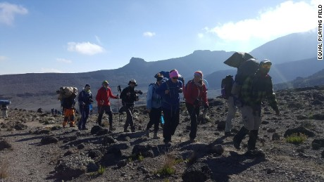 The women trek up Mount Kilimanjaro before playing their match.