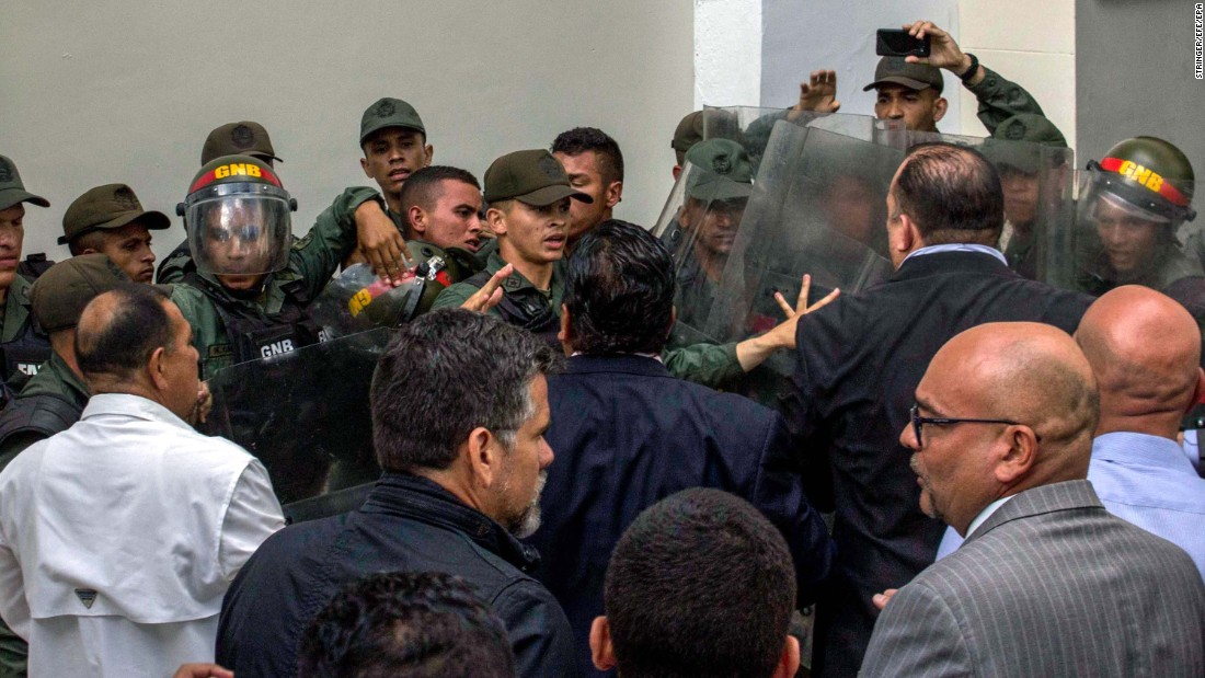 National Guard members clash with deputies of the National Assembly in the Parliament's courtyard in Caracas on Tuesday, June 27.