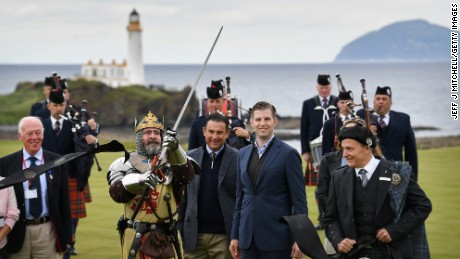 "Eric Trump and his wife Lara (hidden) attend the ceremonial ribbon cutting of the ""King Robert the Bruce"" course at Trump Turnberry."