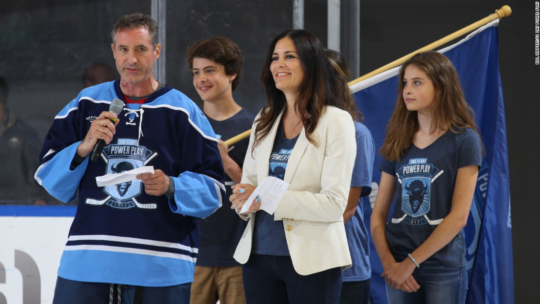 Mike Lesakowksi, along with his wife and children, speaks at the opening ceremonies for his 11-day hockey game.
