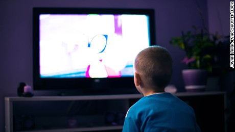 Boy watching television in dark living room; Shutterstock ID 656496229; PO: CNN Photos