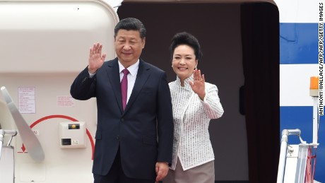 China's President Xi Jinping and his wife, Peng Liyuan, arrive in Hong Kong on June 29.