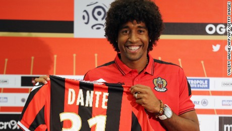 "Nice's defender Brazilian Dante poses with a new jersey after a press conference on August 24, 2016 at the ""Allianz Riviera"" stadium in Nice, southeastern France.   Brazilian centre-back Dante joins Nice in Ligue 1 after completing his move from Wolfsburg. / AFP / VALERY HACHE        (Photo credit should read VALERY HACHE/AFP/Getty Images)"
