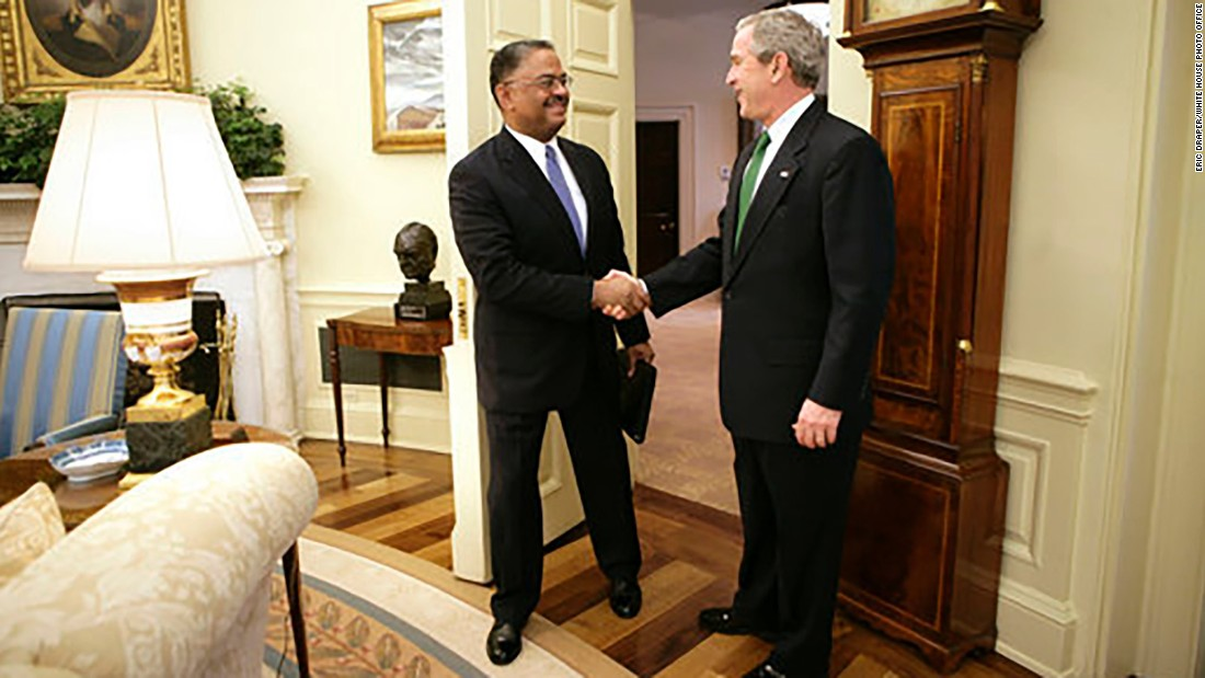 President George W. Bush welcomes U.S. Coast Guard Rear Adm. Stephen W. Rochon to the Oval Office Tuesday, February 20, 2007.  The New Orleans native was announced on that day as director of the executive residence and chief usher.  He was the eighth chief usher of the White House, and the first African-Amerikcan to hold that position.