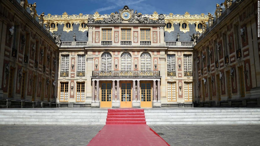 A red carpet set in the courtyard of Versailles.