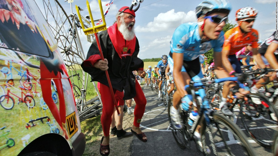 Fancy dress for fans is optional ... Here Didi Senft known as El Diablo cheers on the riders during the 207 km fourth stage of the 93rd Tour de France cycling race from Huy (Belgium) to Saint-Quentin (France), 05 July 2006.