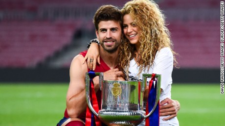 Gerard Pique and Shakira of FC Barcelona pose with the trophy in the final against Athletic Club at the Camp Nou Stadium in Barcelona, Spain, on May 30, 2015.