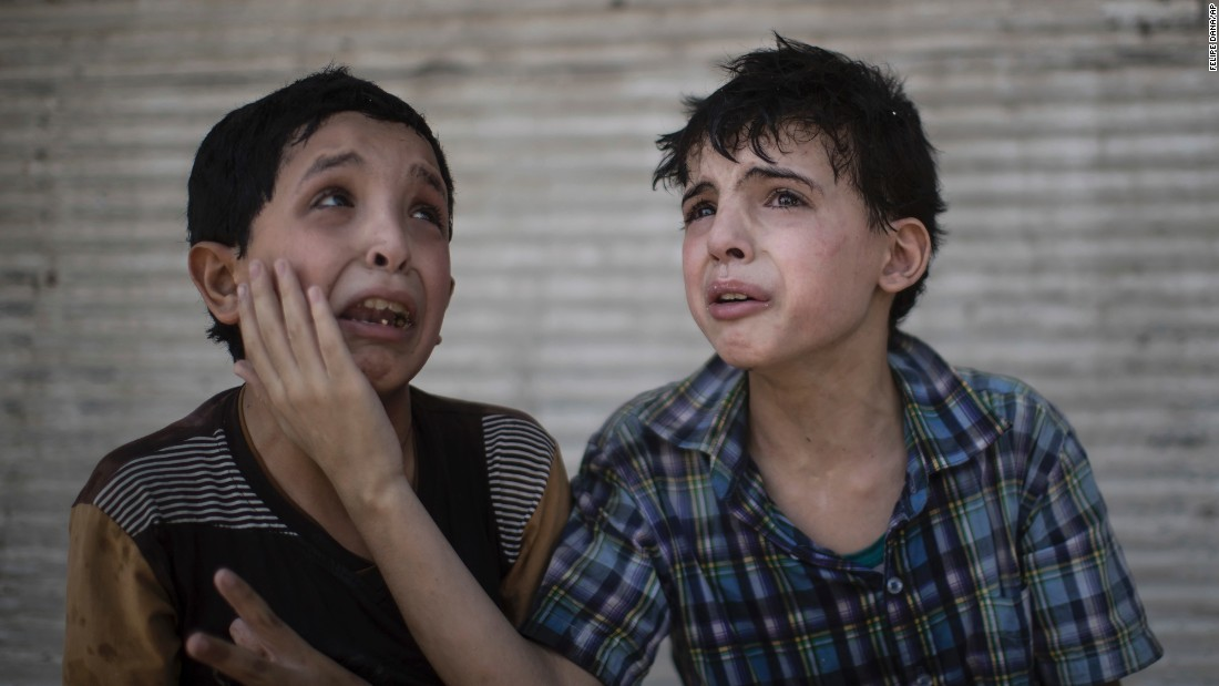 "Cousins Zeid Ali, left, and Hodayfa Ali, comfort each other after their house was hit and collapsed during <a href=""http://www.cnn.com/2017/06/28/middleeast/iraq-isis-death-in-mosul/index.html"" target=""_blank"">fighting between Iraqi forces and Islamic State militants</a> in Mosul, on Saturday, June 24. The boys said some of their family members are still under the rubble."