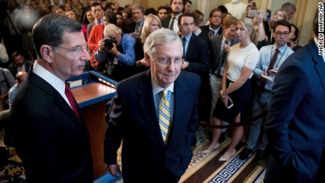Senate Majority Leader Mitch McConnell, R-Ky., joined by Sen. John Barrasso, R-Wyo., left, departs after announcing that he is delaying a vote on the Republican health care bill while the GOP leadership works toward getting enough votes, at the Capitol in Washington, Tuesday, June 27, 2017. (AP Photo/Andrew Harnik)