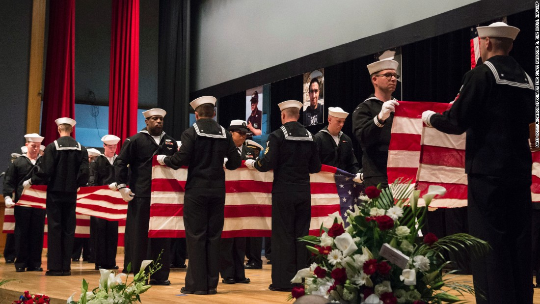 "In this photo released by the US Navy, sailors fold seven US flags during a memorial ceremony on June 27 at Fleet Activities in Yokosuka, Japan,in honor of the seven American sailors assigned to <a href=""http://www.cnn.com/2017/06/22/politics/uss-fitzgerald-investigation-update/index.html"" target=""_blank"">USS Fitzgerald who were killed in the June 17 collision. </a>"