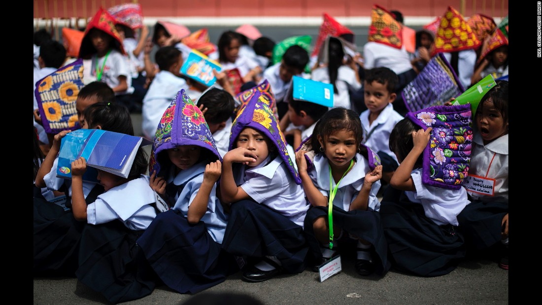 Schoolchildren participate in a nationwide simultaneous earthquake drill in Manila on Thursday, June 29. The nationwide drill is part of the Philippine government's quarterly disaster preparedness program.
