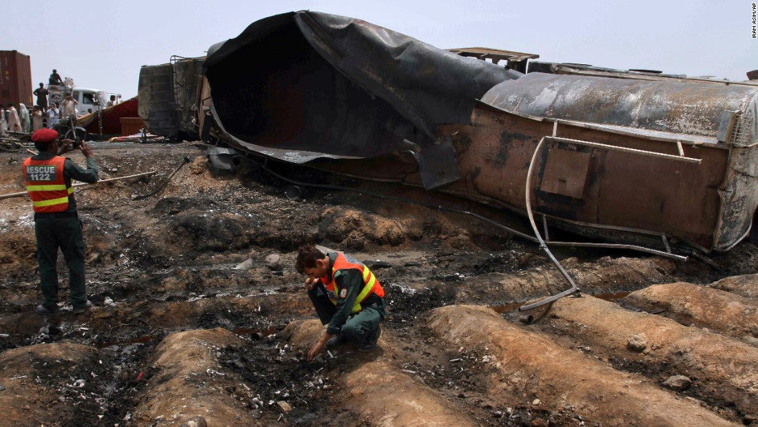 "Pakistani rescue workers examine the site of an <a href=""http://www.cnn.com/2017/06/25/asia/deadly-oil-tank-explosion-pakistan/index.html"" target=""_blank"">oil tanker explosion</a> in Pakistan on Sunday, June 25. At least 153 people were killed in the blast; several had gathered around the tanker hoping to collect leaking fuel, an official said."