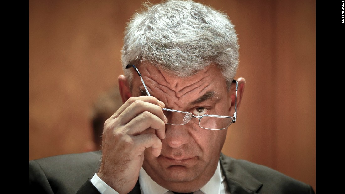 Romanian Premier-designate Mihai Tudose removes his glasses before a parliament vote on the new Romanian government in Bucharest on Thursday, June 29.