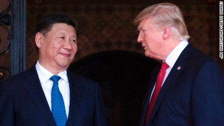 US President Donald Trump (R) welcomes Chinese President Xi Jinping (L) to the Mar-a-Lago estate in West Palm Beach, Florida, on April 6, 2017. / AFP PHOTO / JIM WATSON        (Photo credit should read JIM WATSON/AFP/Getty Images)