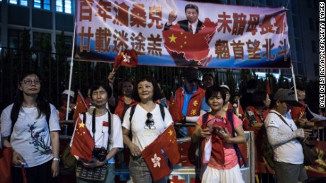 Pro-China supporters gather along a road during Xi's visit  on June 29, 2017.