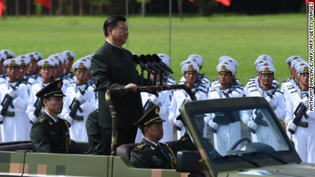 Chinese President Xi Jinping begins a review of troops from a car during a military parade in Hong Kong on June 30, 2017.