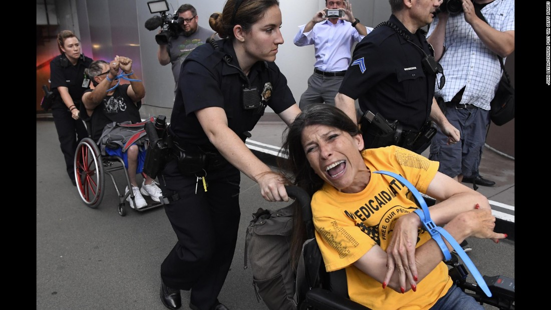 "Police remove protesters from Sen. Cory Gardner's office Thursday in Denver. <a href=""http://www.cnn.com/2017/06/30/politics/protest-denver-cory-gardner-office/index.html"" target=""_blank"">Ten people were arrested</a>, many with disabilities, after staging a two-day sit-in at Gardner's office over the health care bill. As they were arrested, the demonstrators chanted, ""Rather go to jail than die without Medicaid,"" according to CNN affiliate KMGH-TV."