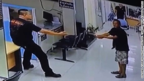Cop stops man with knife, hugs him