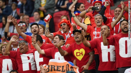 Chile's supporters cheer during the 2017 Confederations Cup semi-final football match between Portugal and Chile at the Kazan Arena in Kazan on June 28, 2017. / AFP PHOTO / FRANCK FIFE        (Photo credit should read FRANCK FIFE/AFP/Getty Images)