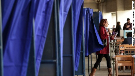 A woman leaves a voting booth prior to casting her ballot at a polling station, during the Municipal elections, in Santiago on October 23, 2016.  Chilean voters went to the polls Sunday for municipal elections that should act as a litmus test for the ruling center-left coalition of President Michelle Bachelet, one year before her term ends. In the elections, which serve as the unofficial opening of the 2017 campaign season, some 14 million voters will choose 346 mayors, plus city councils.  / AFP / MARTIN BERNETTI        (Photo credit should read MARTIN BERNETTI/AFP/Getty Images)