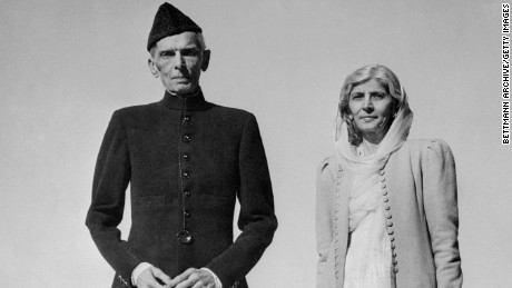 Celebrating his 72nd birthday, Muhammed Ali Jinnah, Governor-General of Pakistan, strolls on the lawn of the Government House in Karachi with his sister, Fatima.