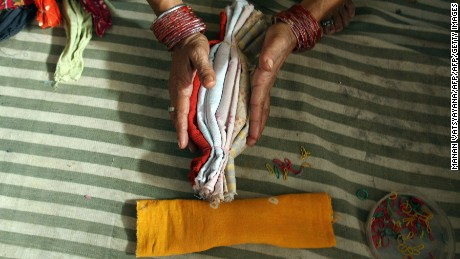 NGOs and aid workers help women make clean and cheap sanitary napkins.