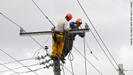 Employees of the electricity company repair the lines in Leon, 95 km northwest of Managua, on May 30, 2008. Tropical Storm Alma left in northwestern Nicaragua, 4000 people homeless, 1200 houses partially damaged and the electric and telecommunication lines severely damage.  AFP PHOTO/Miguel ALVAREZ (Photo credit should read MIGUEL ALVAREZ/AFP/Getty Images)