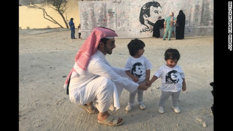 Children in Doha wear T-shirts showing support for the Emir.