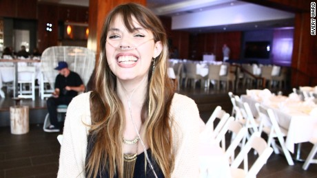 Claire Wineland smiles broadly at a comedy roast to raise money for Claire's Place Foundation in July 2015.