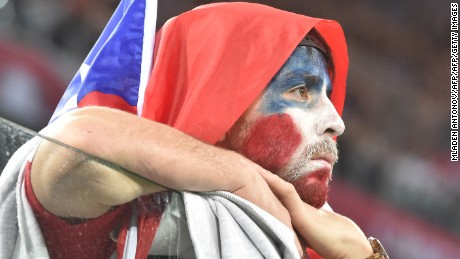 A Chile supporter reacts at the end of the 2017 Confederations Cup final football match between Chile and Germany at the Saint Petersburg Stadium in Saint Petersburg on July 2, 2017. / AFP PHOTO / Mladen ANTONOV        (Photo credit should read MLADEN ANTONOV/AFP/Getty Images)