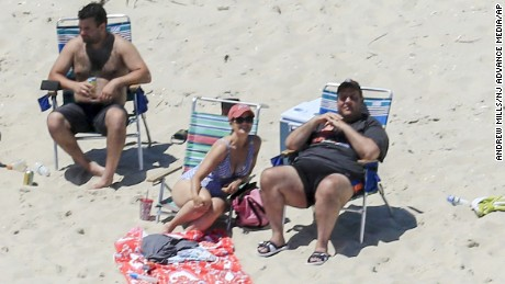 "New Jersey Gov. Chris Christie uses the beach with his family and friends at the governor's summer house at Island Beach State Park in New Jersey on July 2. Christie is defending his use of the beach, closed to the public during New Jersey's government shutdown, saying he had previously announced his vacation plans and the media had simply ""caught a politician keeping his word."""