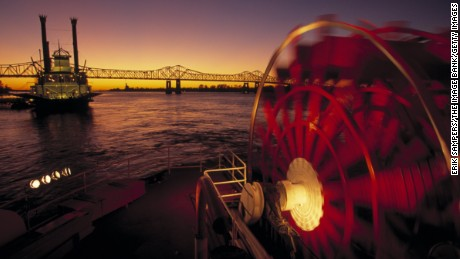 The horizon appears over a steamboat and paddle wheel on the Mississippi River in New Orleans, Louisiana.