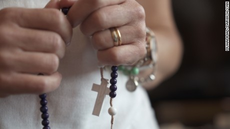 Fatima Alves says she uses her rosary beads three times a day.