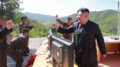 North Korean leader Kim Jong-Un (R) reacting after the test-fire of the intercontinental ballistic missile Hwasong-14 on July 4.
