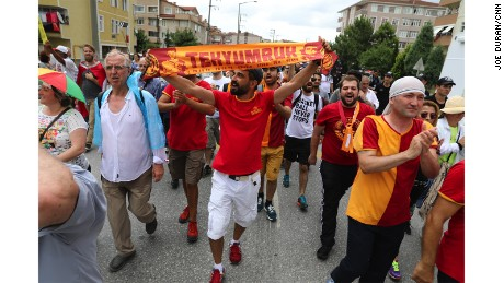 Football fans from the Galatasaray football team joined in the march, adding their stadium chants and songs.