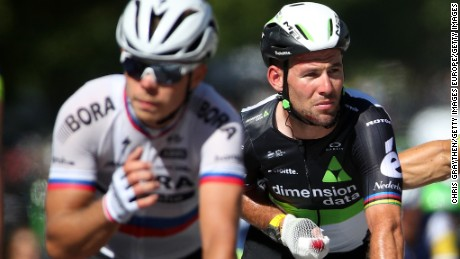 Mark Cavendish (right) is pictured riding for Team Dimension Data.