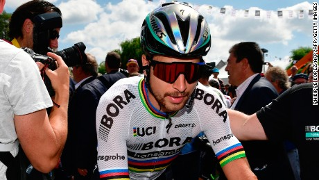 Slovakia's Peter Sagan (C) rides toward the start line prior to the 207,5 km fourth stage of the 104th edition of the Tour de France cycling race on July 4, 2017 between Mondorf-les-Bains and Vittel. / AFP PHOTO / PHILIPPE LOPEZ        (Photo credit should read PHILIPPE LOPEZ/AFP/Getty Images)