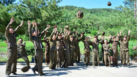 North Korean soldiers celebrate the launch of the Hwasong-14, the country's first tested intercontinental ballistic missile, on July 4, 2017 in this image from North Korean state media.