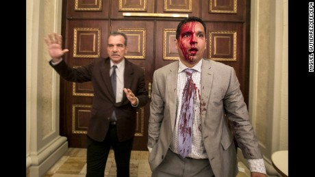 Venezuelan lawmakers Luis Stefanelli, left, and Jose Regnault stand in a corridor of the National Assembly after Wednesday's crash with demonstrators in Caracas.
